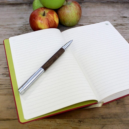 Lined Pages of Appeel Notebook with Pen