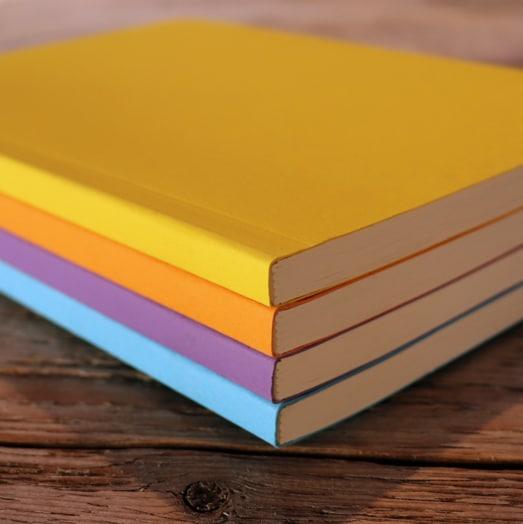 Eco-notebooks-in-yellow-orange-purple-blue