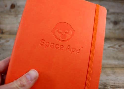 Orange Blind Debossed logo on Notebook