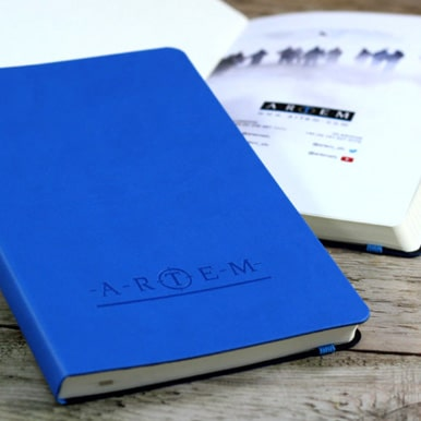Page Insert And Blind Debossed Cover of Blue Castelli Tucson Flexible Notebooks