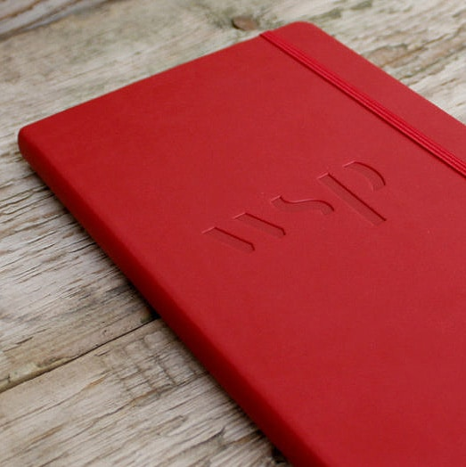 Blind Deboss Customisation on Red Castelli Tucson Notebook